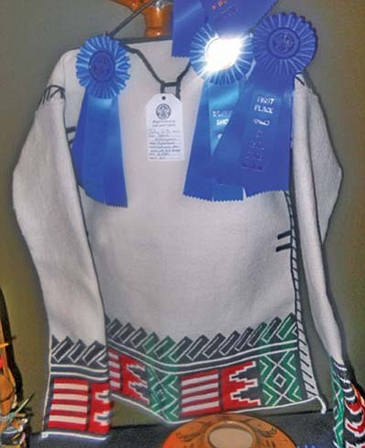 Rosanda Suetopka Thayer/NHO<br> Winning this year's Hopi Show's Best of Show Award was Daniel Kelhoyouma. He was recognized because of his traditonal textile entry of a paired set of traditionally embroidered woven cotton shirt and a men's traditionally embroidered kilt sash.