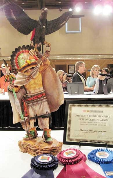 "Rosanda Suetopka Thayer/NHO<br> Stetson Honyumptewa won Best of Show at last year's 2010 Santa Fe Indian Market with his breathtaking sculpture kachina piece titled ""Messenger of Rain."" It was the first time that SWAIA awarded two artists together this special win"