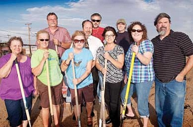 Todd Roth/NHO<br> Standing On The Corner Board of Directors smile after breaking ground on Eagle Pavilion  July 6. Pictured from left are Yvonne Howeth; Leslie Ramsey, Treasurer; George Cullum, President; Deb Cullum; Greg Hackler, second Vice President; Vince Lugo, Vice President; Pauline Hernendez; Bert Peterson; Stephanie Lugo, Secretary; and, Tom McCauley. Not present are Loren Sadler and Shirley King.