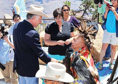 Ryan Williams/NHO<br> Secretary of the Interior Ken Salazar shakes hands with a member of the Uqualla family during a visit to Grand Canyon's South Rim last month.