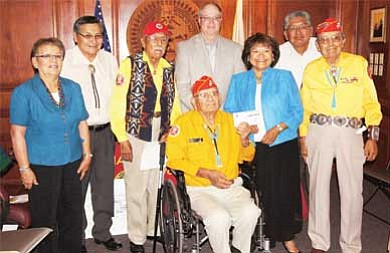 Submitted photo<br> Pictured from left are First Lady Martha Shelly, President Ben Shelly, Samuel Tso, G. Brad Brown, Lena Fowler, Walter Begay, Frank Chee Willetto and seated in front, Keith Little, gathered for the special ceremony.