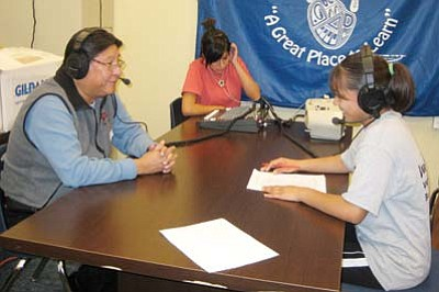 "Photo/Stan Bindell<br> Burt Poley getting interviewed by Hopi High School's Otivia ""Big O"" Puhuhefvaya on  KUYI."
