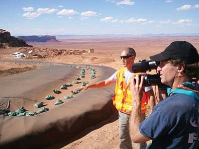 Submitted photo<br> A film crew captures the construction of a Uranium holding pit sparked by the movie