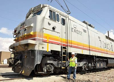 Photo/George Hardeen<br> Judy Moffett is the first woman and first Navajo to become a train operator for the Black Mesa Lake Powell Railroad. Every day, the railroad delivers 26,000 tons of coal from the Peabody Energy twin coal silos along U.S. 160 to the Navajo Generating Station at LeChee.