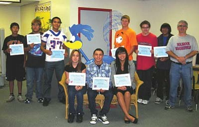 "Submitted photo<br> Holbrook High School recently announced August Students of the Month. Pictured are (seated from left) Bianca Sample (Spanish), Daniel Foster (Career Technical Education), and Camilla Bitsoie (English). Standing from left are Lyle Billy (Math), Aarick Yazzie (Social Studies), Frank Martin (Physical Education), Ronnie ""the Roadrunner,"" Nathan Turley (Science), Dakota Williams (English), Ethan Aspas (Reading), and Principal Lance Phaturos"