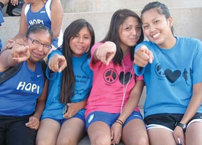 Stan Bindell/NHO<br> Hopi High girls are all smiles after placing second at the Hopi Invite. They are pointing to their wonderful fans