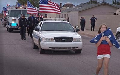 Todd Roth/NHO<br> Emergency services, Boy Scouts and Hopi High Drill Team marches through Winslow Sept. 11.
