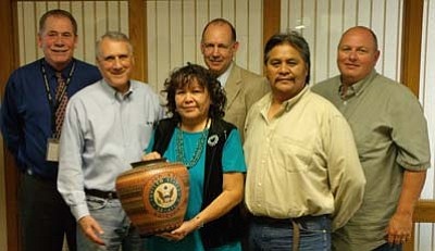 Submitted photo<br> Navajo County Sheriff K. C. Clark, County Attorney Brad Carlyon and Chairman of the Board of Supervisors David Tenney present Senator Jon Kyl with a pot crafted by Heber artists Herb and Juanita Wilson to thank the senator for his support of the county's successful petition to be designated as a federal High Intensity Drug Trafficking Area.