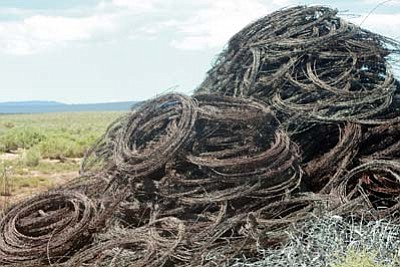 Submitted photo<br> A pile of barbed wire sits along one of the ranches awaiting use.