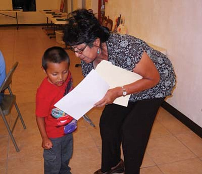 Rosanda Suetopka-Thayer/NHO<br> Kaye Pooyouma runs the award winning Hopi preschool program. Pooyouma presented certificates of completion to her students at the final summer end dinner. Pictured is Jared Sahneyah, age 3, one of Pooyouma's outstanding students.