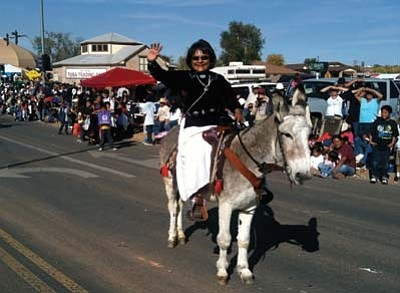 Photo/George Hardeen<br> Coconino County District 5 Supervisor Lena Fowler rode the honorable donkey at the  Western Navajo Fair Parade in Tuba City last Saturday. Fowler said this was her way to honor the memory of Chief Manuelito and Navajo values of old. Her trusty mount is Jumpin' Jack Flash and is owned by Cleveland Haskan of Kayenta.