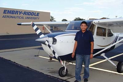Photo/George Hardeen<br> Tyler Allen, 16-year-old Window Rock High School junior, attended the Embry-Riddle Aeronautical University Flight Exploration Program in Prescott this summer. He was assisted by a scholarship from the Page/Lake Powell Community Foundation Navajo Youth Achievement Fund. Behind him is a Cessna 172SP Skyhawk from the of Embry-Riddle fleet. .