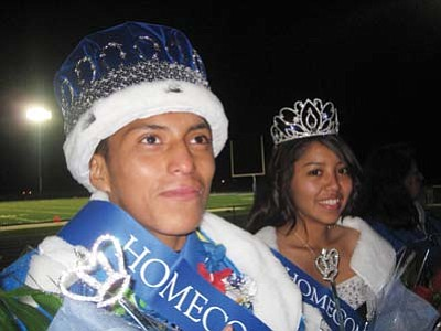 Stan Bindell/NHO<br> Homecoming King Macray Huma and Homecoming Queen Freda Haskin bask in the glow of winning at the football game.