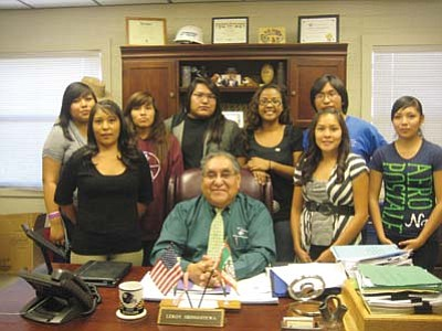Stan Bindell/NHO<br> Hopi Chairman Leroy Shingoitewa recognized the Hopi High radio and journalism programs. The students surronding him are, from left, Tamara Joe, Holly Joy Lomatska, Mary Grace Pewewardy, Anthony Antone, Christina Rucker, Sheldon Nanacasia, Kaitlin Billy and Shacely Miguel.