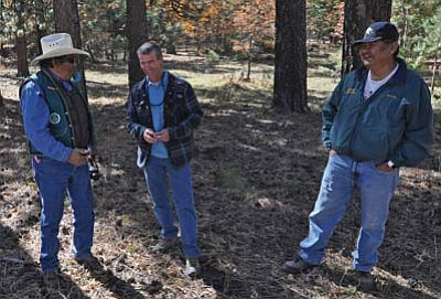 Photo/Patrick Lair<br> Nelson Roanhorse (left), a Bureau of Indian Affairs timber management officer, and Robert Billie (right), a Navajo Nation forester, share a laugh with Garry Domis (middle), a Kaibab National Forest silviculturist