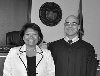 Submitted Photo<br> Chairwoman Lena Fowler stands next to Justice of the Peace Howard Grodman at the first hearing.