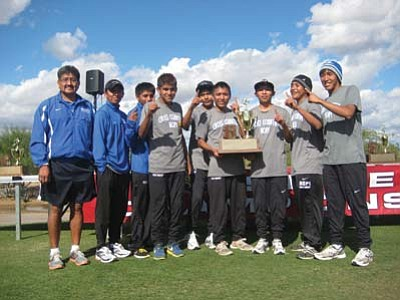 Stan Bindell/NHO<br> Hopi High boys smile for the camera after they won their national record 22nd straight state cross country championship.