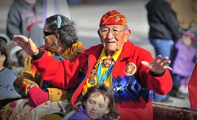 Todd Roth/NHO<br> One of the few remaining Navajo Code Talkers honors people at the parade with his appearance.