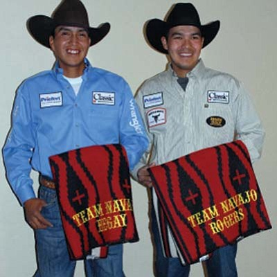Submitted Photo<br> Derrick Begay and Erich Rogers are all smiles during the ceremony that was held for them.