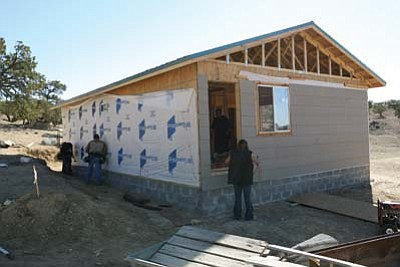 Submitted photo<br> NTC carpentry students erected a two-bedroom house for veteran Dan Jim Nez of Mariano Lake, N.M. Navajo Technical College's carpentry program is heavily rooted in providing hands-on experience for its students through community outreach.