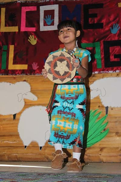 Submitted photo<br> Little Miss NTC, Charmalea Caddo, performs a traditional basket dance as part of her talent.