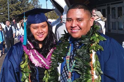 Gary Elthie/NHO<br /><br /><!-- 1upcrlf2 -->(Right to left): Jordan Begay, from Cowsprings, Ariz., graduated with a Health Science degree with a minor in Biology.  He is a graduate of Tuba City High School. He plans on getting his graduate degree in the Physician Assistant Program. Proud parents are Wilson and Lita Begay. Leina Fisher, from Nanakuli, Hawaii, got her degree in Hotel and Restaurant Management. She is the daughter of Olinda and Waldron Fisher.