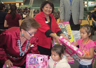 Tyler Tawahongva/NHO<br> First Lady Shelly and Supervisor Lena Fowler help hand out toys at the event.