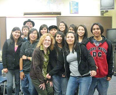 Stan Bindell/NHO<br> A Hopi High English class poses with poet James Baca.