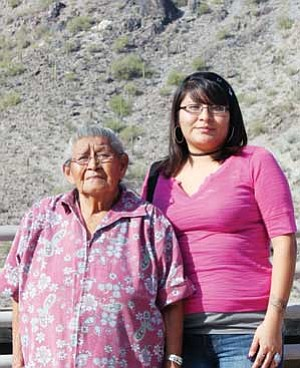 Sara Muchvo stands along side her grandmother, Vivian Muchvo, after receiving her scholarship from the Northern Arizona Native-American Foundation at the foot of Piestewa Peak.