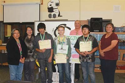 Submitted Photo<br> TCJHS Spelling Bee winners pose with staff. From left are Mrs. Dottie Sumatzkuku, Mrs. Joan Cayme, Patrick Malazarte, Shane Moran, Mr. Dennis Bowen, Jawaan Provencial and Ms. Evelyn Kiyaani.
