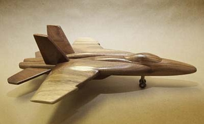 One of the many pieces available at the February 10 art auction.  A hand carved walnut model of a F18E by Dale Patton.