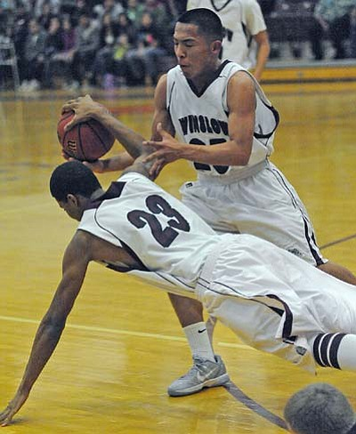 Todd Roth/NHO<br> Senior guard Tremayne Nez, 25, and Junior point guard Tito Johnson, 23, fight for the ball during the Page game.