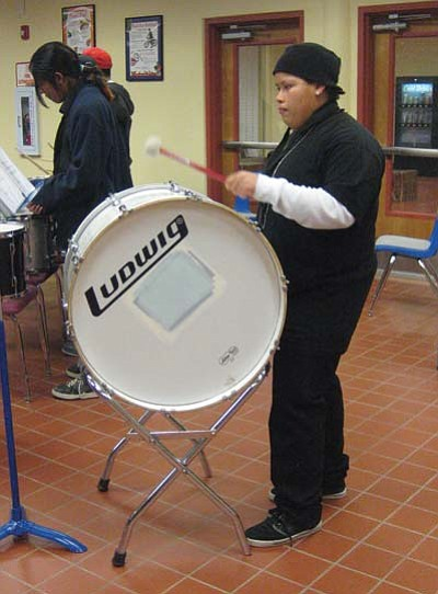 Stan Bindell/NHO<br> Jasmine Morgan concentrates on learning how to play the drum.