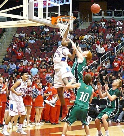 Anton Wero/NHO<br> A Thatcher Eagle tries tp dunk the ball against two Holbrook defenders in the semi-final game. Thatcher was defeated in the finals by Gilbert Christian.