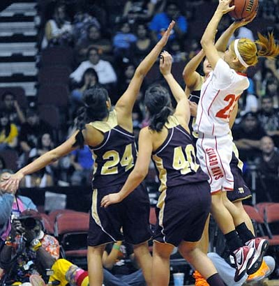 Todd Roth/NHO<br> A Lady Sand Devil takes a difficult shot in the championship game while surrounded by three Winslow Bulldogs trying to block her attempt.
