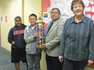 Stan Bindell/NHO<br> Hopi Junior High Spelling Bee Champ Nicholai Bolus (second from left) received plenty of congrats. The others are, from left, Bryonna Morgan, Hopi Junior High Principal Albert Sinquah and advisor Rita Keith.