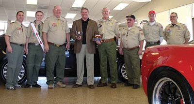Robb Smart/NHO<br> Terry Marxen shows of his Citizen of the Year award, surrounded by Boy Scout leaders.