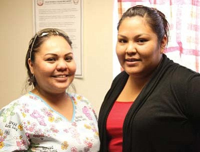 Submitted Photo<br> NTC nursing instructor Shawnadine Becenti (left), poses with NTC Student Senate President Sharon Cooley. Becenti was nominated by the NTC student body as Faculty Member of the Year for the 2011-2012 school year.