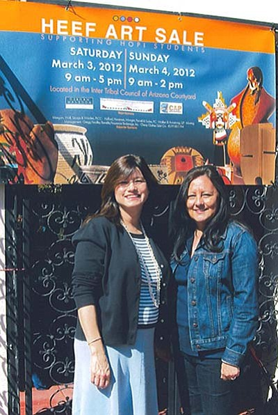 Submitted Photo<br> HEEF President Eileen Egan and Vice President Terri Hines stand at the entrance of the art sale.