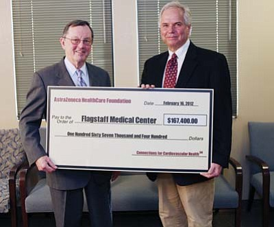 Submitted Photo<br> Timothy J. Gardner, MD, trustee, AstraZeneca HealthCare Foundation, presents Bert McKinnon, MD, Board of Directors Chair, Northern Arizona Healthcare, a check for $167,000 for the Northern Arizona Diabetes-Heart Connection program.