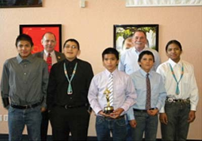 Submitted Photo<br> Shonto Preparatory Academy students Kiamana Lameman, Kyle Sandoval, Raymon Wagner, Jonathan Bowsley and Bernard Bennett took first place in a teen anti-drinking video contest sponsored by Navajo County Attorney Brad Carlyon. Sheriff K. C. Clark is also pictured.