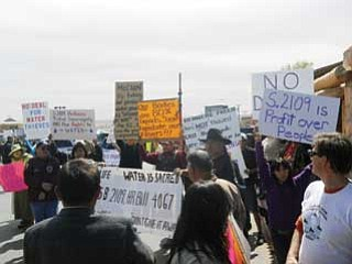 "Hopi and Navajo grassroots protestors showed up in the hundreds in Tuba City to show their joint tribal solidarity in voicing objections to any further negotiations or approval of the ""Hopi Navajo Little Colorado Water Settlement Agreement"" and to protest the senatorial visit by Republicans Jon Kyl and John McCain."
