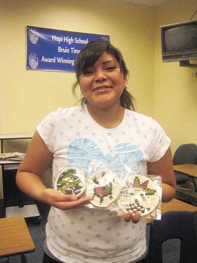 Jewel Kagenveama with her Hopi coil baskets.