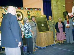 Families of the Hopi Code Talkers were present to witness the formal unveiling of a specially commissioned bronze plaque that bears both the English and traditional Hopi names of each Hopi Code Talker. Smaller versions of the formal plaque with metal etched photo plates were also given to each surviving family by the Hopi Veterans' Administration Director Eugene Talas.