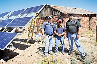 The Pump Canyon solar panels and installation crew includes (from left) Jeff Coleman, Dave Hartman and Dave Perez.