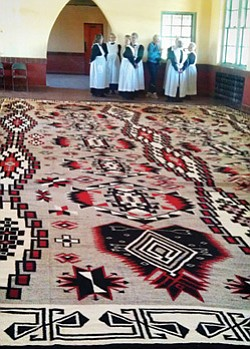 The world's largest Navajo rug is prominently displayed inside the historic train depot at La Posada Hotel. <i>Todd Roth/NHO</i>