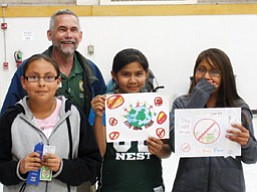 Eagle's Nest Intermediate School (pictured from left) winning students include Tori Fulton, County Attorney David Rozema, Teneeshia Bedonie and Angel Natonie. <i>Submitted photo</i>