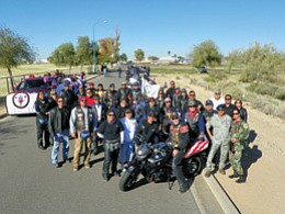Navajo Hopi Honor Riders will take to the highways and reservation area roads for three days May 15-17 honoring and reminding the watchful public of the sacrifice and heroism of all American soldiers in active and non-active duty. Here, more than 300 current Navajo Hopi Honor Riders take a break at Sacaton, Ariz.
