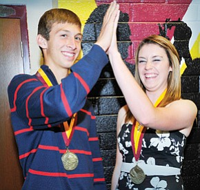 Winslow High School Valedictorian Lorin Greenwood and Salutatorian Kelley Pugh are all smiles as they give each other a high five.