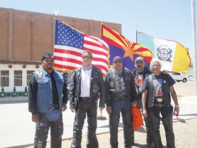 The 2012 NHHR Honor Riders display a cross-tribal force representing varied nations including, Hopi, Navajo, Pima and Japanese on opening day. Pictured left to right are Reggie Curry, one of the original Honor Riders from Lower Mungapi-Tobacco Clan; Michael Kotutwa Johnson, new recruit to NHHR-Kykotsmovi-Fire Clan; Byron Poocha, original Honor Rider, First Mesa/Blackwater, Deer Clan-Akimel Clan; Nolan Dempsey, original Honor Rider-Towering House Clan-Oaksprings, Ariz.; and TeChan-Japanese, a former veteran from Kykotsmovi who has lived and worked on the Hopi Reservation for over 20 years.